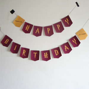 Guirlande d'anniversaire Harry Potter avec les couleurs de Gryddonfor